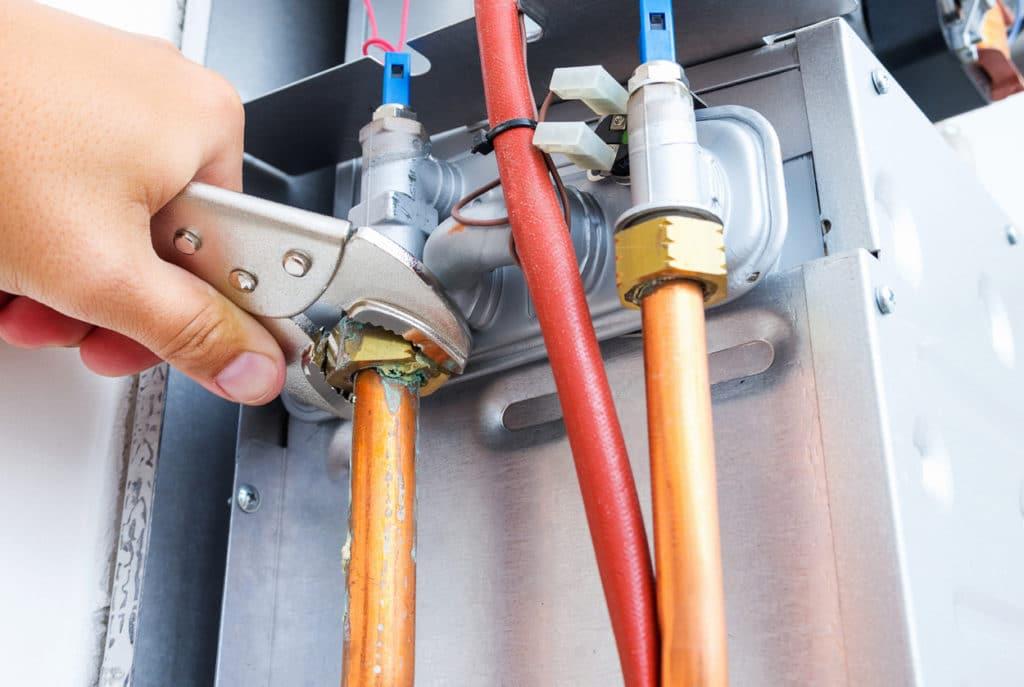 Plumber repairing a gas boiler